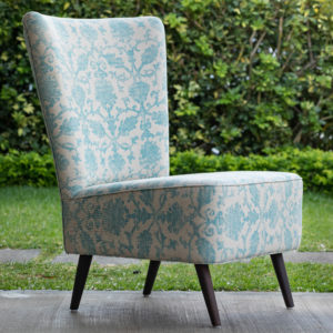 accent chairs for the social area in this residence were custom made with a beautiful printed fabric to add color
