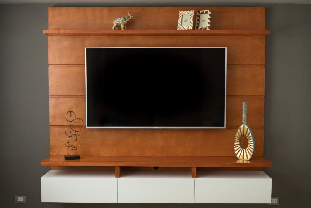 entertainment center for this remodel was made in cedar wood with very clean lines