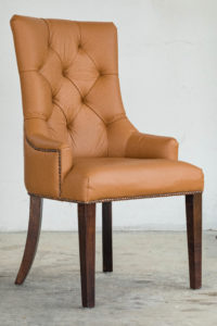 this tufted leather chair makes the residence look elegant and classy