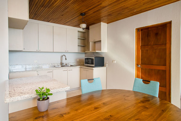 this kitchen was totally renovated with new wall color and cabinets