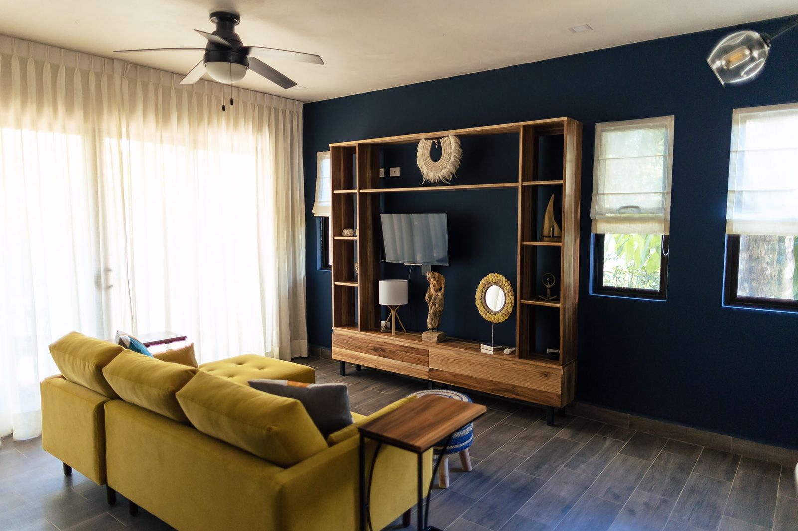 bold dark blue color accent wall in living room