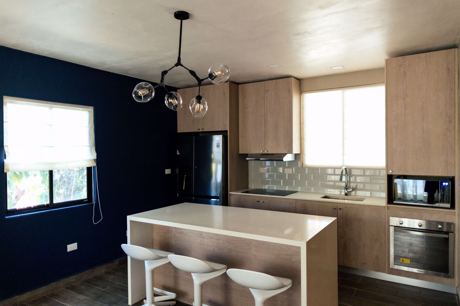 view of the kitchen and blue accent wall