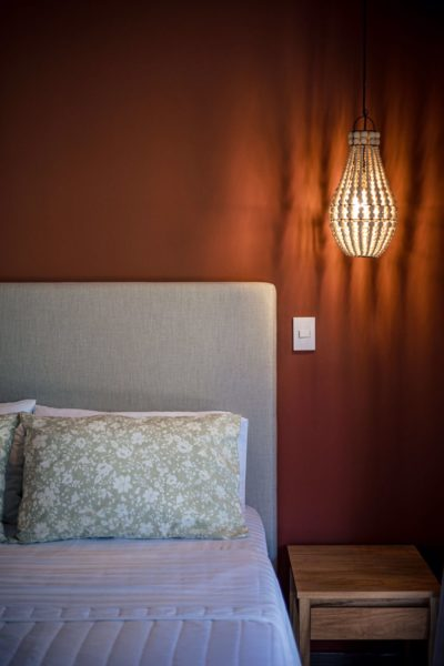 bedroom with natural wood light fixtures