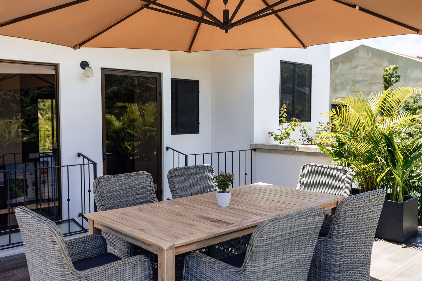 modern design patio with umbrella for comfort