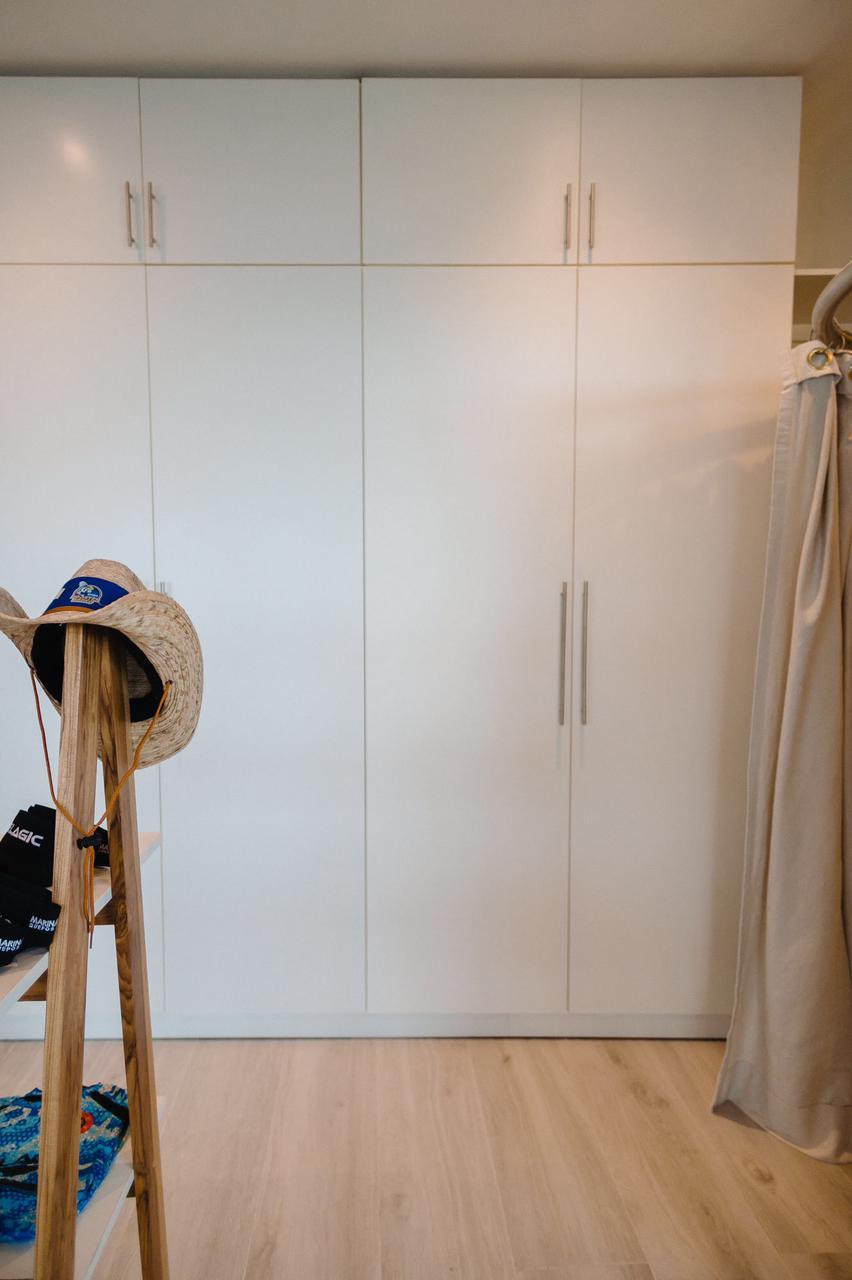 Plain white minimizes storage cabinets while providing lots of space